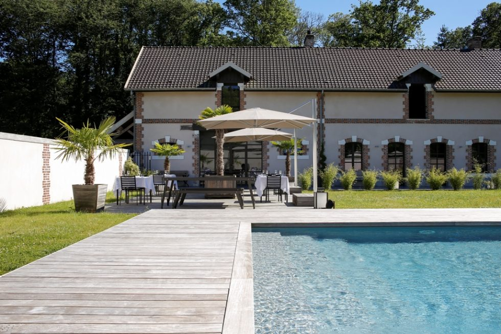 Pool and terrace of Château de la Resle Spa hotel in Burgundy France