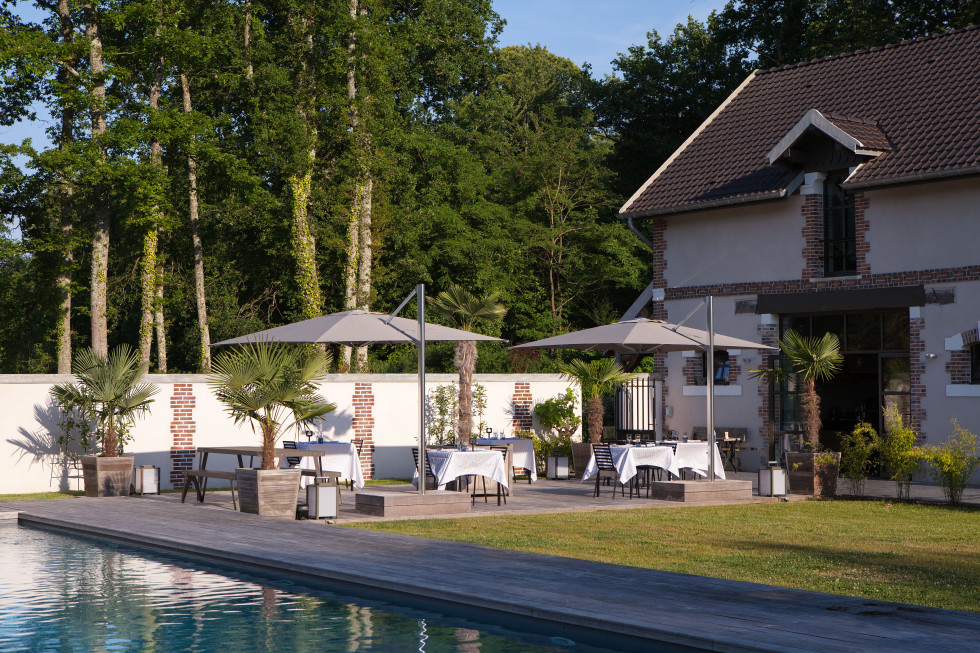 Gourmet restaurant terrace at Château de la Resle, boutique hotel with art and design in Burgundy France