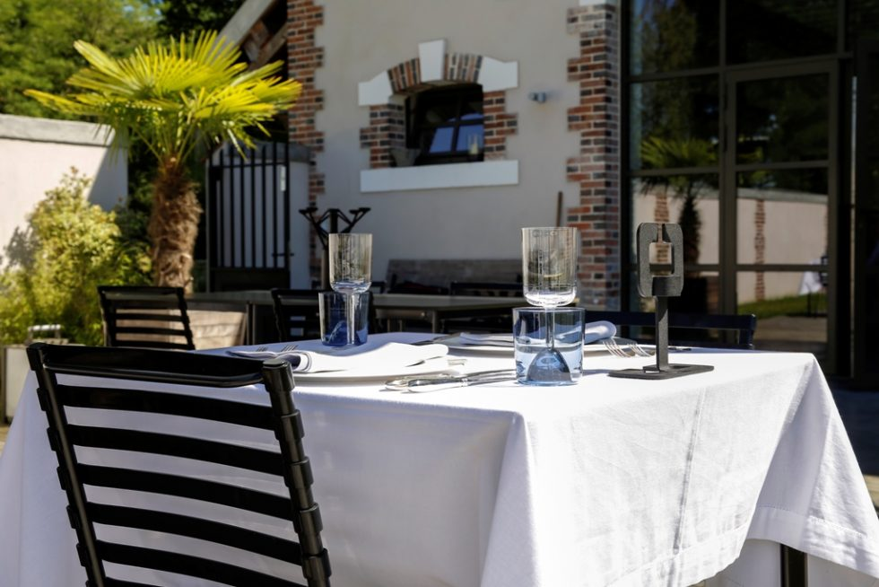 Dining outside at the gourmet restaurant of Château de la Resle luxury hotel in burgundy France